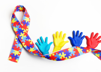 Autism awareness concept with colorful hands on white background.